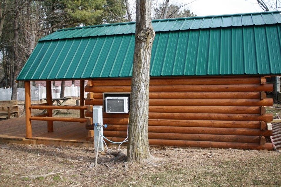 Log home maintenance staining and cleaning for Log cabin restoration